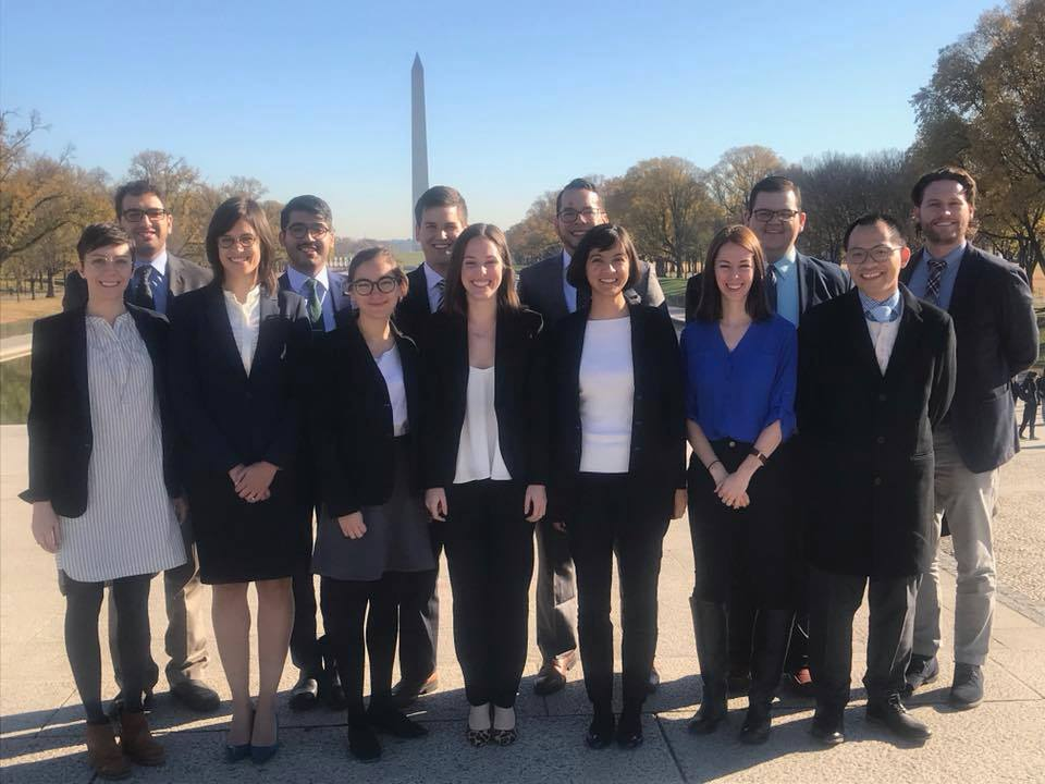 Participants at a graduate recruiting even pose in Washington, DC.